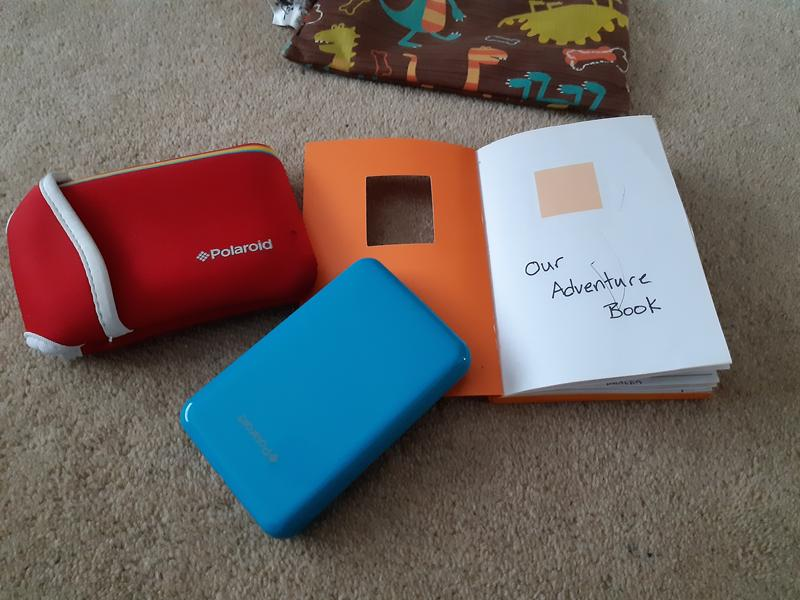 Blue Polaroid Printer with notebook