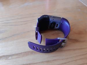 Fitbit surge with broken watch band and gaffer tape holding it together.