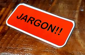 A laminated card with the word 'Jargon' written on it.