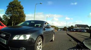 Black car overtaking very closely.